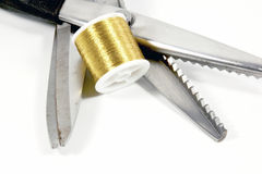 Pinking Shears Scissors And Reel Of Gold Thread Royalty Free Stock Photos