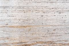 Pinkish sandstone - facing stone texture background. Fragment royalty free stock photo