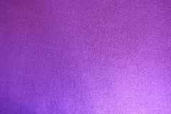 Pinkish violet knitted fabric from above. Pinkish violet thin knitted fabric from above Stock Images
