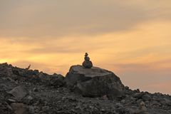 Pinnacle or Pyramid of Stones on the Volcano Peak, at Sunset, on Vulcano Island, Italy.  royalty free stock images
