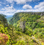 Pinnacle Rock, Mpumalanga, South Africa. The Pinnacle Rock, a tower-like freestanding quartzite buttress which rises 30 m above the dense indigenous forest in stock images