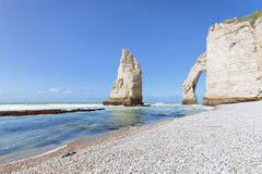 Pinnacle rock and natural arch at Etretat, France Royalty Free Stock Photos