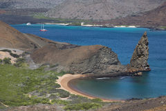 Pinnacle rock and a sublime beach, Bartolome island Stock Photography