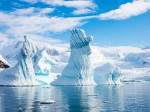 Pinnacle shaped iceberg in Andvord Bay near Neko Harbour, Antarc. Pinnacle shaped icebergs floating in Andvord Bay near Neko Harbour, Antarctic Peninsula Stock Images