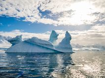 Pinnacle shaped iceberg in Andvord Bay near Neko Harbour, Antarctic Peninsula, Antarctica. Pinnacle shaped icebergs floating in Andvord Bay near Neko Harbour stock photography