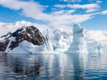 Pinnacle shaped iceberg in Andvord Bay near Neko Harbour, Antarctic Peninsula, Antarctica. Pinnacle shaped iceberg floating in Andvord Bay near Neko Harbour stock image