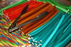Pinnar av den färgrika godisen Fotografering för Bildbyråer
