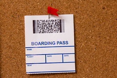 Pinned boarding pass. On cork background Stock Image
