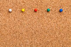 Pinned on corkboard. Corkboard noticeboard thumbtack announce announcement background royalty free stock photography