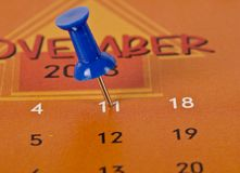 Pinned date on a calendar. Concept of a pinned date on a calendar royalty free stock photos