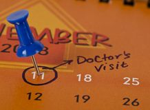 Pinned date for doctors visit. Concept of a pinned date for a doctors visit royalty free stock photography