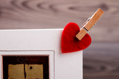 Pinned heart on card. Royalty Free Stock Photo