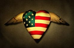 Pinned heart. Pinned winged heart in US national colors royalty free stock photos
