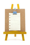 Pinned note on corkboard with wooden stand Stock Photo