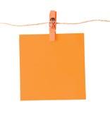Pinned orange notepad isolated on white background Stock Photo