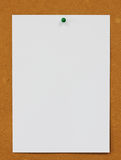 Pinned paper with cork board background. Royalty Free Stock Photos