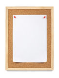 Pinned paper, notice board. Blank white piece of A4 paper is pinned to a cork notice board. Copy Space. Isolated on white royalty free stock photo