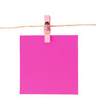 Pinned pink notepad isolated on white background Stock Photography
