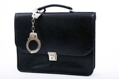 Pinned to bag from metal fastening handcuffs Stock Photography