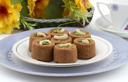 Punjabi Pinni. Pinni is a type of Punjabi and North Indian cuisine dish that is eaten mostly in winters. It is served as a dessert and is made from desi ghee Royalty Free Stock Photo