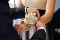 Pinning Boutonniere Stock Photos