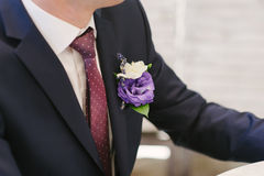 Pinning a Boutonniere Stock Images