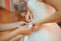 Pinning Brooch to Wedding Dress Stock Photography