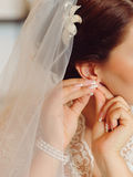 Pinning Earring Stock Photo
