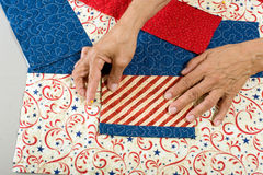 Pinning front pocket. A quilter pins the front pocket onto front of tote bag Stock Photos