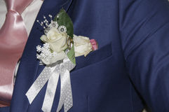 Pinning the Groom with boutonniere flowers Royalty Free Stock Photo