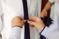 Pinning Groom's Tie Royalty Free Stock Images