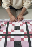 Pinning quilt top  to backing. Royalty Free Stock Photography