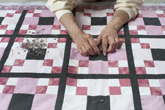 Pinning quilt top  to backing. Stock Image