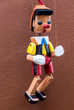 Pinnochio marionette on wall Stock Photography