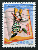 Pinocchio. A stamp printed in Italy shows Pinocchio Royalty Free Stock Images