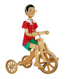 Pinocchio in bicycle Royalty Free Stock Photo