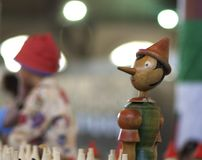 Pinocchio in blurred background. stock images