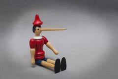 Pinocchio con la nariz grande Foto de archivo libre de regalías