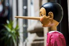 Pinocchio docka som göras från trä Royaltyfria Foton