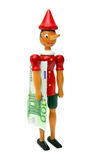 Pinocchio with 100 euro, Wooden Toy Royalty Free Stock Photos