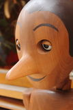 Pinocchio, the italian wooden puppet. A smiling Pinocchio, the italian wooden puppet Stock Photos