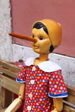 Pinocchio, the italian wooden puppet. A smiling Pinocchio, the italian wooden puppet Stock Image