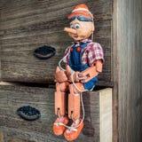 Pinocchio-Marionette gemacht vom Holz Stockbilder