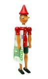 Pinocchio mit 100 Euro, hölzernes Spielzeug Lizenzfreie Stockfotos