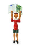 Pinocchio mit 100 Euro, hölzernes Spielzeug Lizenzfreies Stockfoto