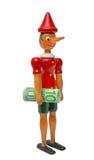 Pinocchio mit 100 Euro, hölzernes Spielzeug Lizenzfreie Stockbilder