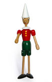 Pinocchio. This photo of a wooden Pinocchio done indoors under artificial light. Was used a tripod and special lamps Royalty Free Stock Image