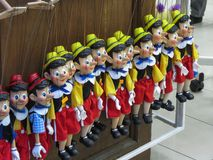 Pinocchio puppets for sale in Prague. PRAGUE, CZECH REPUBLIC - CIRCA DECEMBER 2017: Pinocchio puppets for sale in Prague Royalty Free Stock Images