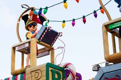 Pinocchio rides on a float in Disneyland Parade. Pinocchio is riding on top of the giant Toy Factory float in Disneyland's A Christmas Fantasy Parade. Very royalty free stock photos