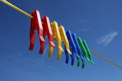 Pinos da lavanderia dos Pegs de roupa Imagem de Stock
